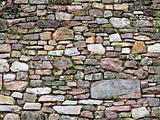 Old wall of stones of a medieval castle
