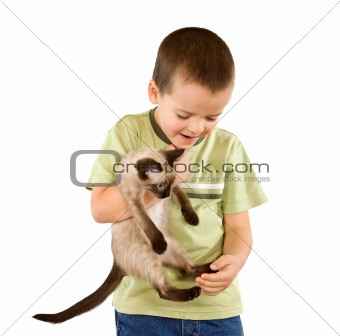 Little boy carrying his cat