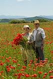 Senior couple on the flower field
