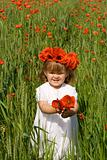 Little girl on the green wheat field with poppies