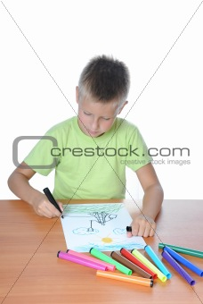 Young boy studies to draw