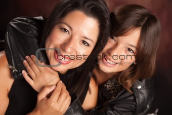 Attractive Hispanic Mother & Daughter Studio Portrait.