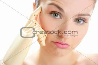 woman portrait thinking with mannequin hand
