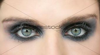 Green eyes woman, black makeup eye shadow