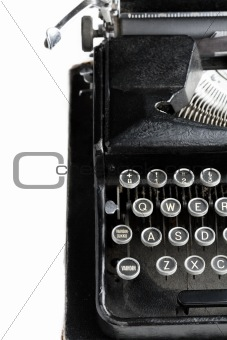 Antique typewriter on white.