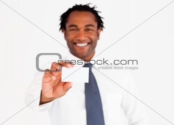 Afro-American busdinessman holding white card