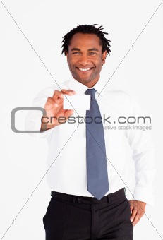 Smiling businessman holding white card