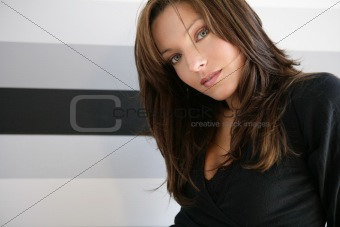 Beautiful blue eyes woman, dress on black