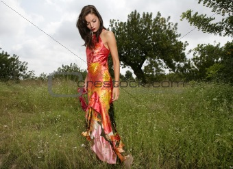 woman haute couture on the forest outdoors