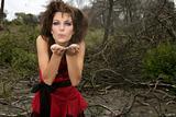 Beautiful woman, black magic on burned forest