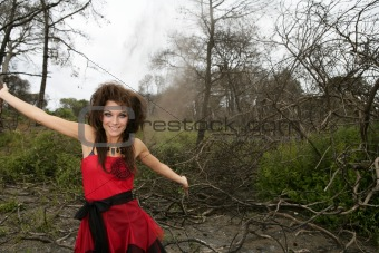 Beautiful woman, black magic on burned forest