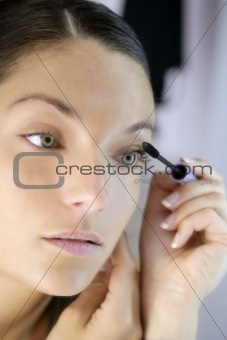 Beautiful woman portrait on the mirror makeup