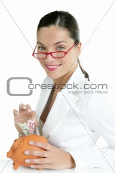 Beautiful businesswoman with piggybank  over white