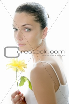 Beautiful woman portrait with yellow rose