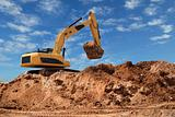 Excavator bulldozer in sandpit