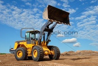 wheel loader bulldozer in sandpit