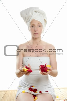Woman on her knees holding rose petals