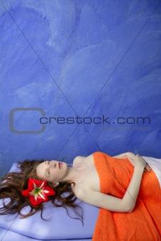 Beautiful redhead woman in massage blue board
