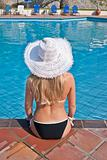 Young blond woman at swimming pool