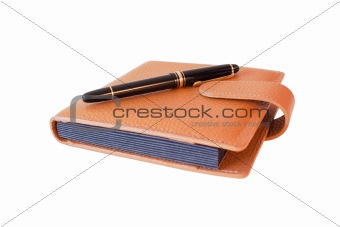 Fountain pen on diary isolated