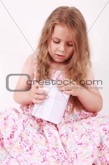 Little girl opening present