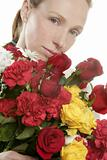 Beautiful woman holding a flowers bouquet