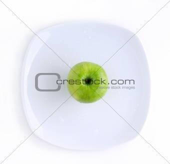 Green apple in the plate