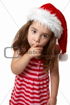 Santa girl hushing or gesturing for quiet