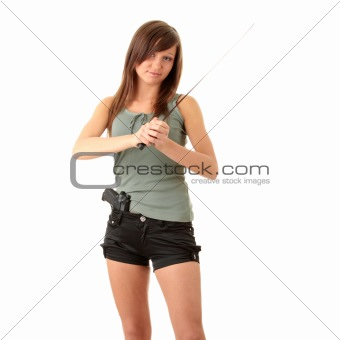 Beautiful girl holding a black gun