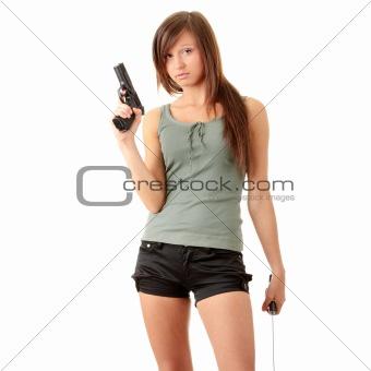 Beautiful girl holding a black gun