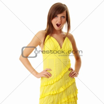 Beautiful brunette girl in yellow dress.