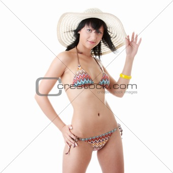 Beautiful brunette with summer hat