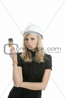 beautiful businesswoman with hammer and helmet