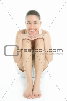 Beautiful young woman relax sit on white