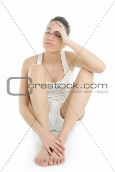 Beautiful woman stress headache sit on white