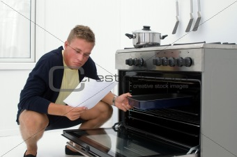 young man clueless in kitchen
