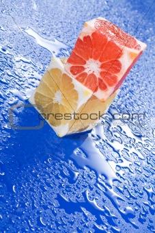 Citrus cubes on wet surface