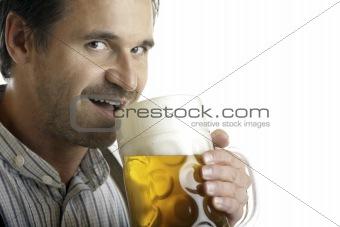 Bavarian man drinks out of Oktoberfest beer stein