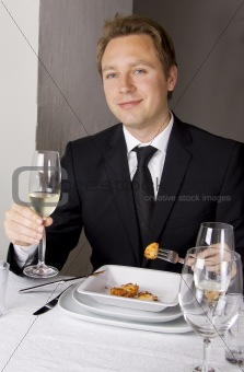 Business man is having lunch
