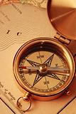 Antique brass compass over old USA map