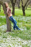 young pretty girl on the park meadow