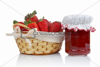 Jam jar and basket of strawberries