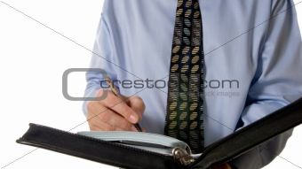 Business man writing in leather organizer