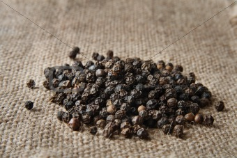 black pepper on a burlap canvas