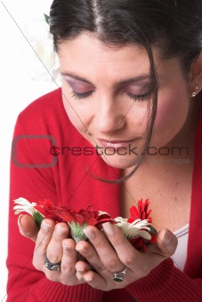 Beautiful woman smelling the flowers