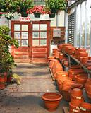 Flower pots and doors of greenhouse