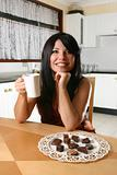 Woman indlulges in chocolate and coffee