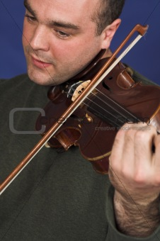portrait of man playing violon