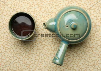 Antique chinese teapot and a cup of tea