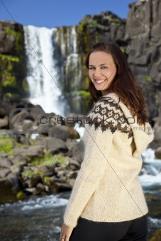 Beautiful Young Scandinavian Woman By A Waterfall